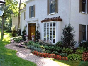 Gorgeous gardens invite visitors to this attractive Main Line residence