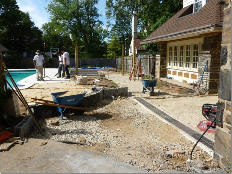 "A ""before"" picture, our crew removed a large deck and more than 36 tons of concrete before completing the light grading and installation of the irrigation system. (Image via aardweglandscaping.com – Main Line Philadelphia PA)"