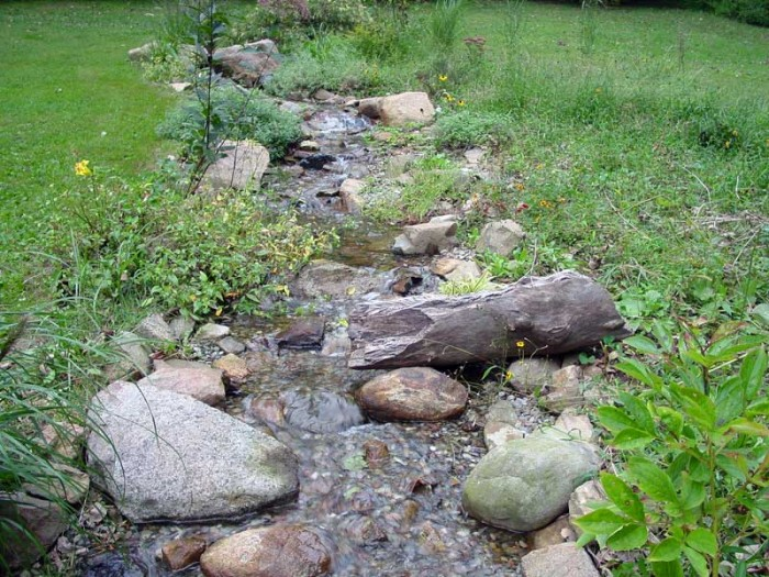 A sustainable lawn and garden design seeks to utilize rainwater
