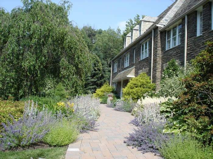 Picture of a landscaped pathway lined with flowers