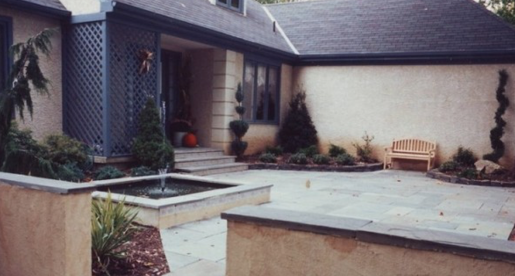 Front porch with a small landscaped fountain
