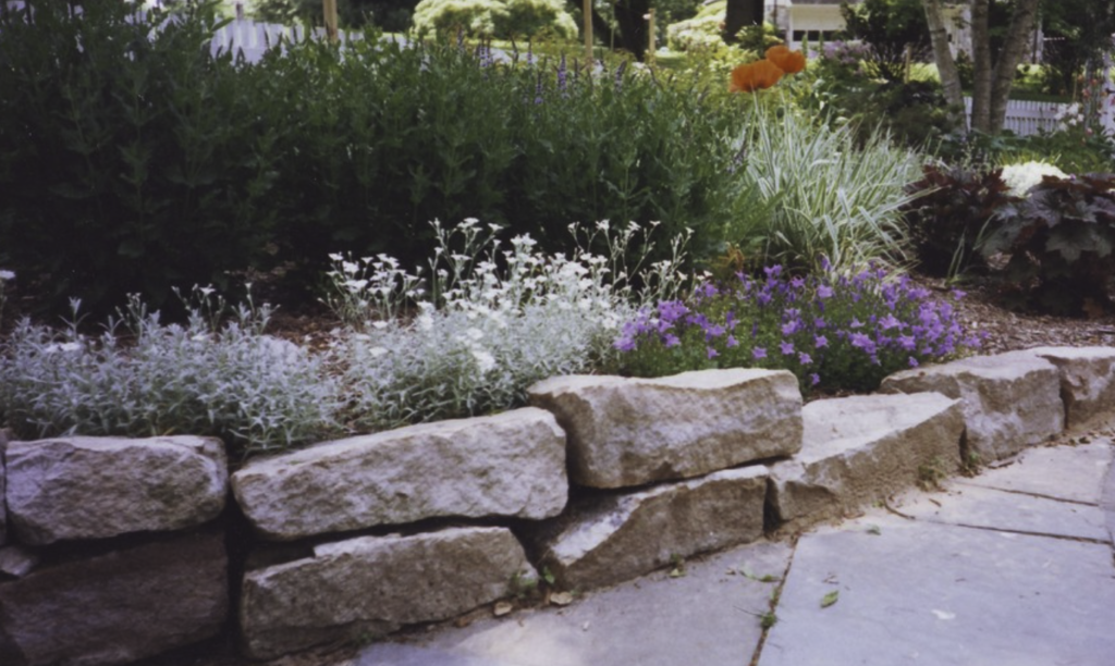 Retaining wall with bright, natural flowers